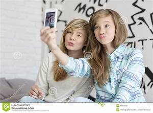 Cute Sisters Pouting While Taking Photos With Smart Phone ...