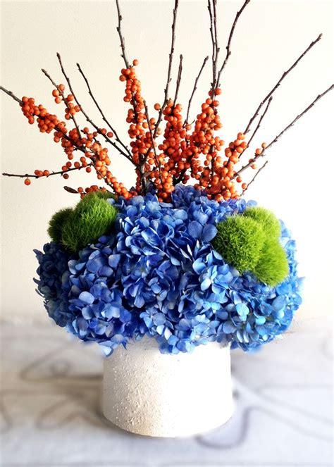 simple diy blueorange centerpiece  hydrangea ilex