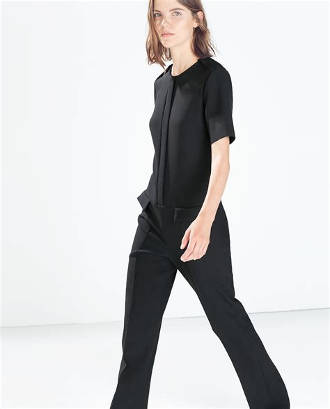 black fitted jumpsuit zara fitted jumpsuit with flap pockets in black lyst