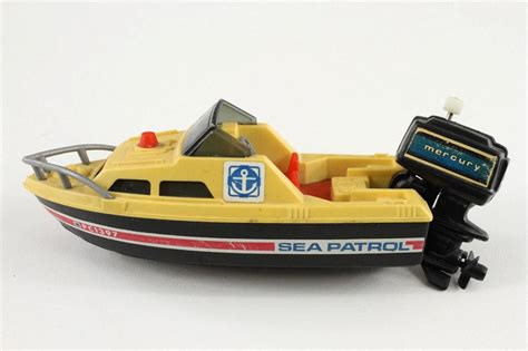 Toy Boat In Sea by Vintage Plastic Toy Tomy Sea Patrol Boat Mercury Wind Up