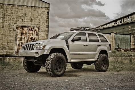 raised jeep grand cherokee lifted silver jeep grand cherokee jeeps pinterest