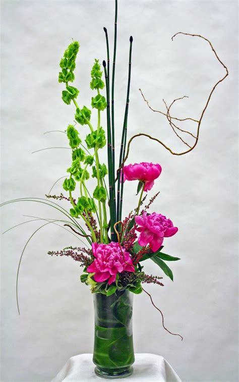 tall modern floral arrangement  pink peonies bells