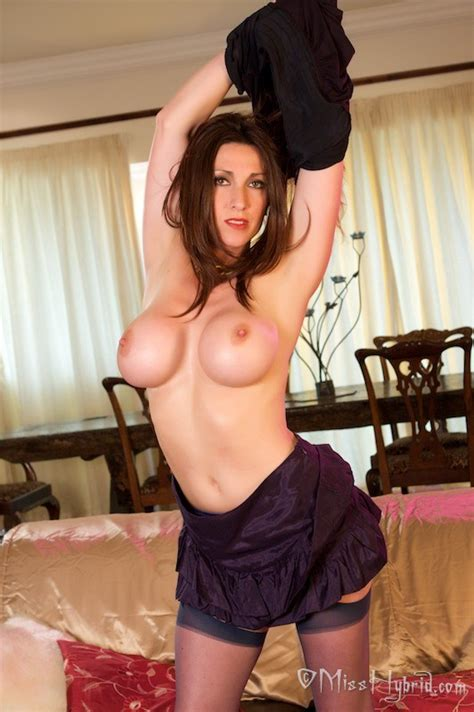 Miss Hybrid Posing In Stockings Strips Sexy Lingerie
