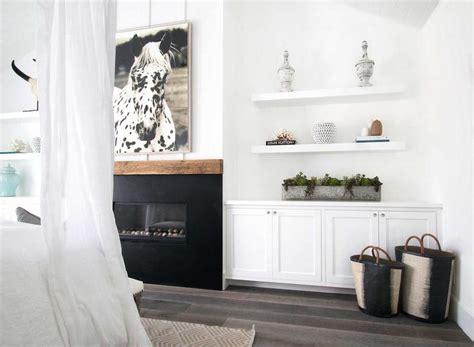 bedroom fireplace  built  shelves  cabinets