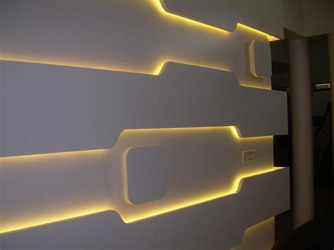 combine cove lighting and raised panels for unique subtle