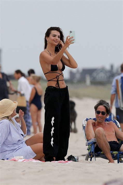 Emily Ratajkowski – In a bikini relaxes on the beach in ...