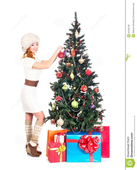 happy woman  winter clothes decorating  christmas