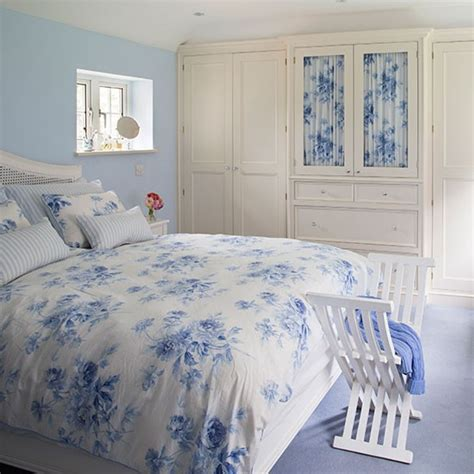 pale blue bedroom with floral bedspread decorating