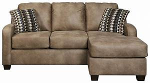 Contemporary faux leather sofa chaise by benchcraft wolf for Sectional sofas wolf furniture
