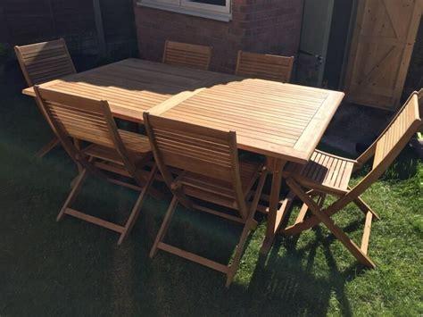 roscana teak wooden outdoor  seater extending dining set
