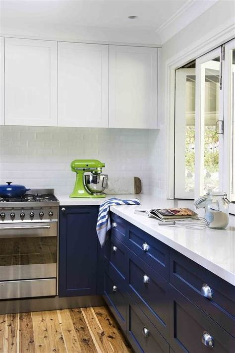 white and navy kitchen cabinets navy lower kitchen cabinets with brass pulls