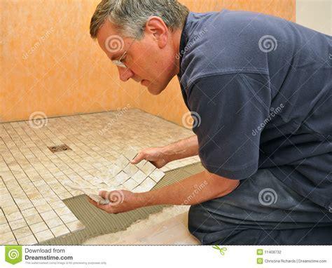 Man Installing Ceramic Tile In Bathroom Stock Photo