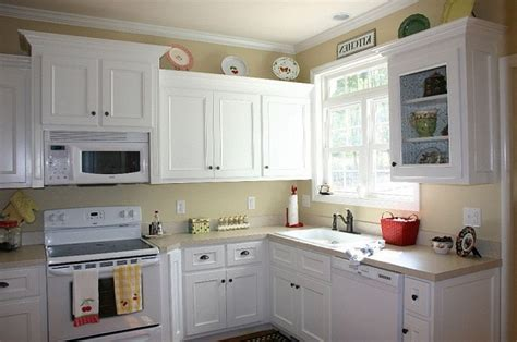 painting kitchen cabinets without removing doors how i painted my kitchen cabinets without removing the