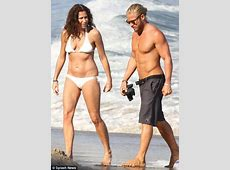 Minnie Driver shares a beach kiss with new toyboy who