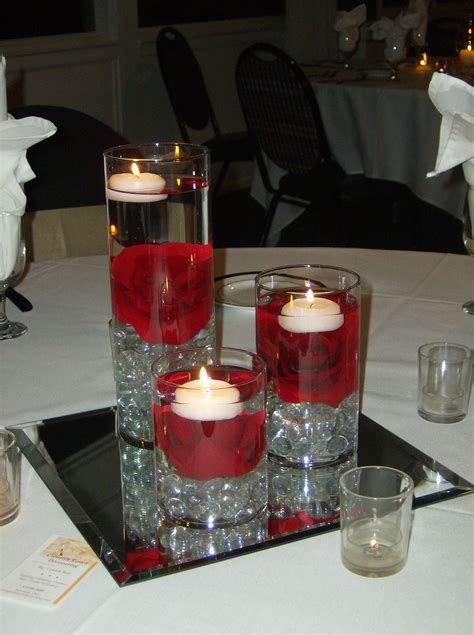 Cylinder Glasses With Red Rose Inside And White Candles