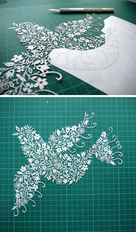 artist hand cuts insanely intricate paper art  single