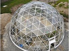 Solar Geodesic DomeCovered Cob House Rises in the Far