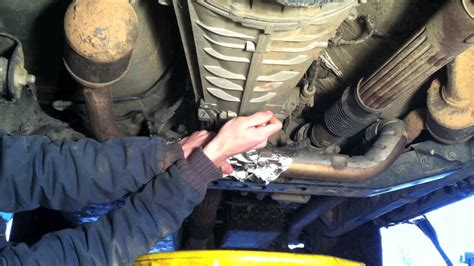 how to fix a leak under the how to change manual transmission fluid jeep wrangler
