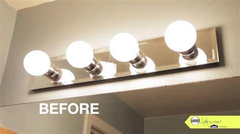 bathroom makeover tip replace  bathroom lighting