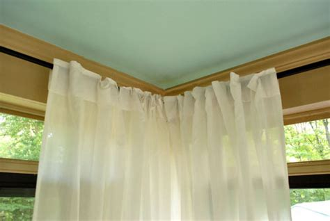 how to hang corner curtain rods painting the ceiling