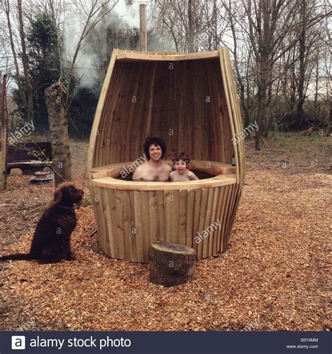 Outdoor Tub by And In A Outdoor Tub Being Watched By A