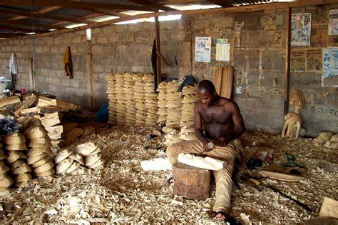 picture man making art wood souvenirs workshop