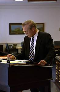 File:Donald H Rumsfeld works at a stand-up desk jpg