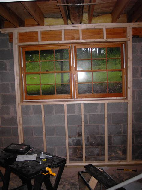 Insulating Ceiling Panels by Basement Basement Framing