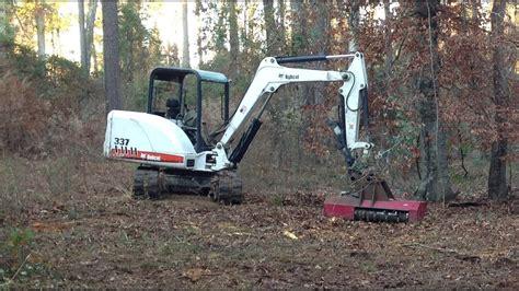 bobcat mini excavator  torrent mulcher clearing small trees midi   trackhoe mower