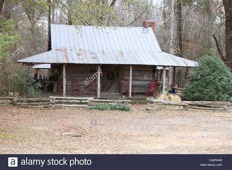 Log cabin with a tin roof Stock Photo, Royalty Free Image