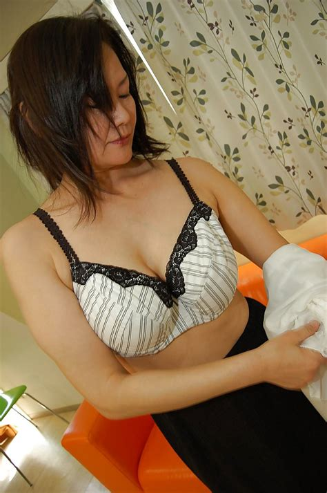 asian milf kaoru mitamura getting naked and demonstrating her juicy twat