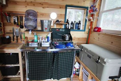 young couple build mortgage   grid micro cabin