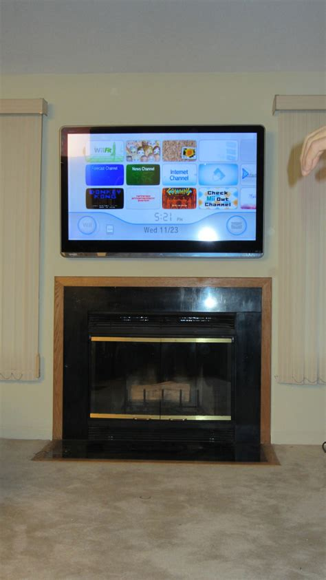 Bloomfield, Ct Tv Mounted On Wall Above Fireplace  Home. Navy Wallpaper. Oriental Lamps. Beachy Backsplash. Rectangular Chandelier. Rustic Picture Frame. Blue Bahia Granite. Green Leather Chair. Interior Columns