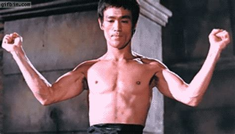 bruce lee flexing muscles  funny gifs updated daily