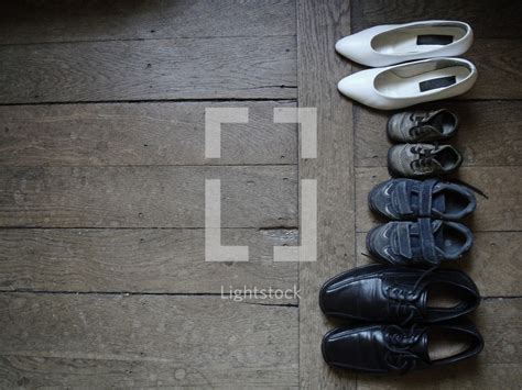 shoes for wood floors family s shoes lined up on a wood floor photo by inbetween lightstock