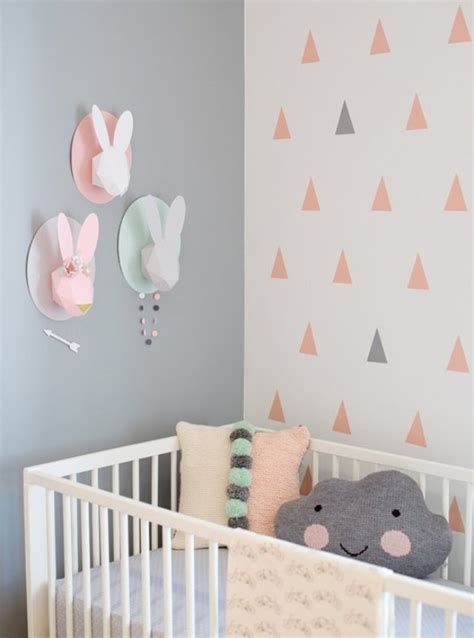 modern and cozy baby nursery with trendy triangles