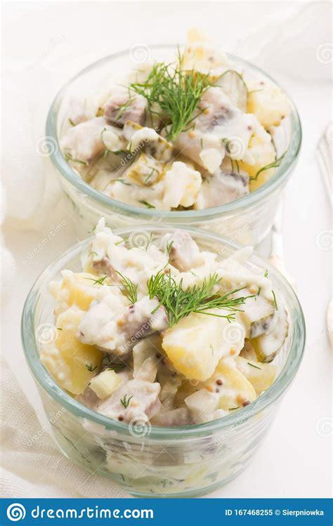 Salad Rasols Made Of Herring, Cucumber And Potato, Dressed ...