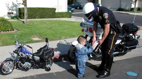 Baby Biker On His Fast Motorcycle Gets A Speeding Ticket