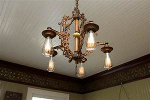 antique light fixture in dining room - Hooked on Houses