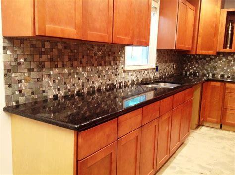 black glass backsplash black galaxy granite countertop kitchen traditional with