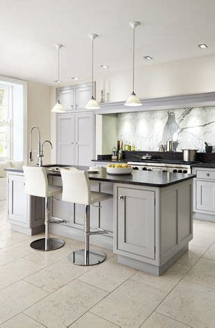 black counters grey cabinets  white walls