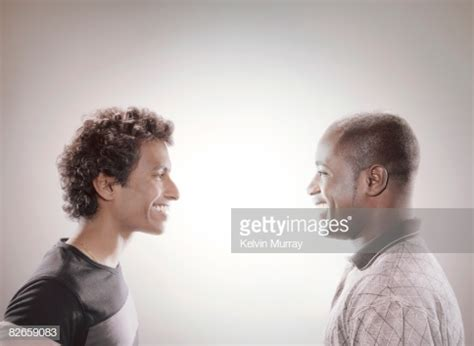 men facing    smiling stock photo getty