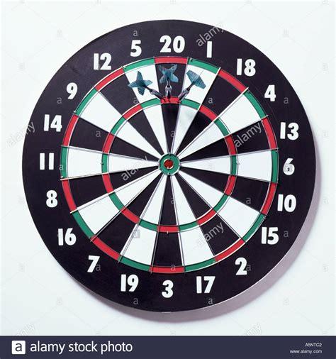 tip darts three darts on a dartboard scoring 180 stock photo