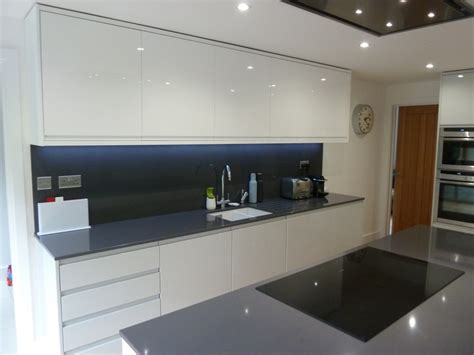 white tile backsplash white gloss and dove grey kitchen fitted in welwyn