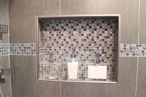double shower niche witn metal trim  decorative glass