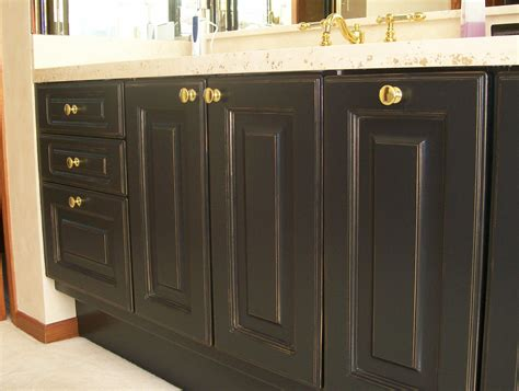 Transforming Stained Oak Cabinets Into Black Beauties With