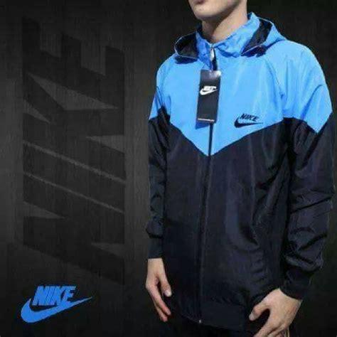 jual beli jaket parasut biru turkis kombinasi hitam windrunner grosir baru jaket kulit