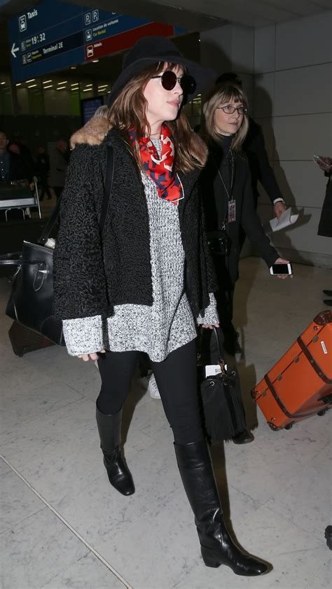 DAKOTA JOHNSON at Charles De Gaulle Airport in France ...