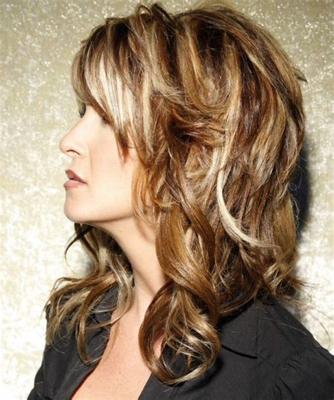 long wavy casual hairstyle with side swept bangs caramel