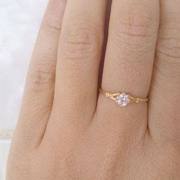 Shop Tiny Engagement Ring On Wanelo. 1.6 Engagement Rings. Half Eternity Rings. Black Jade Rings. Pure Silver Engagement Rings. Sustainable Engagement Engagement Rings. Cradle Wedding Rings. Complicated Engagement Rings. Basket Engagement Rings